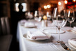 canvas print picture - A close up shot of a restaurant table set up with tableware and wine glass. Concept of dining, hospitality and catering. Horizontal image with free space for text.