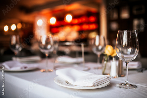 Obraz A close up shot of a restaurant table set up with tableware and wine glass. Concept of dining, hospitality and catering. Horizontal image with free space for text. - fototapety do salonu
