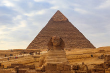 Egyptian Great Sphinx And Pyra...