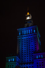 Palace Of Culture And Science Illuminated In The Nighttime In Warsaw, Poland