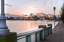 Sunset Over A Neighborhood Lake Located In Elk Grove California