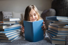 Cute Little Girl Reading Book