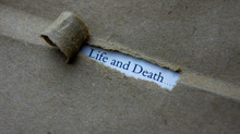 Torn Paper With Text Life And Death