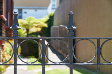 Wrought Iron Gate In Front Of Walkway