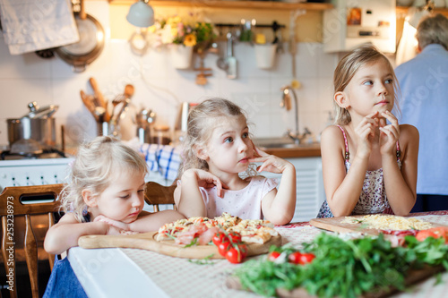 Children Are Waiting For Dinner Three Hungry Kids Sitting At Family Table With Hot