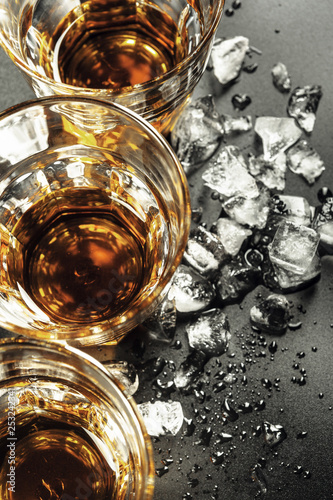 Foto op Aluminium Alcohol Whiskey and ice on rustic wood background