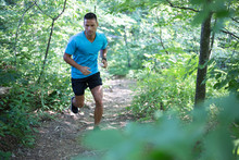 Young Man Running In The Woods...