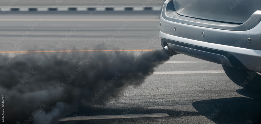 Fototapeta air pollution crisis in city from diesel vehicle exhaust pipe on road