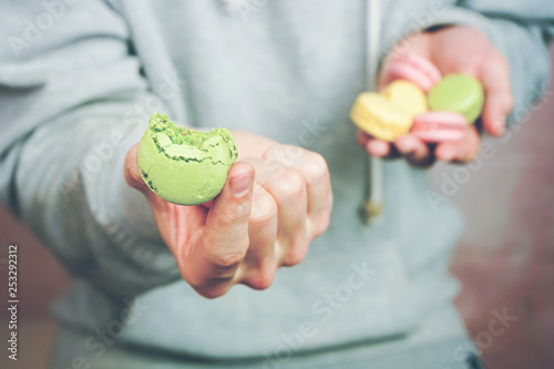 Staande foto Macarons Man holding macaroins in his hands