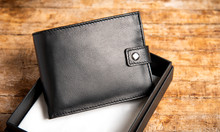 Black Leather Wallet On A Wooden Table
