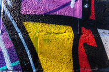Background With Painted Wall Texture With Bright Colors And Funny Graffiti.