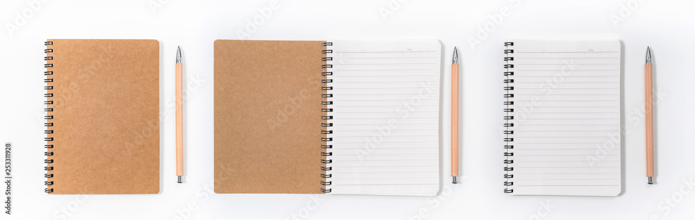 Fototapeta Brown spiral notebook isolated on white background.top view