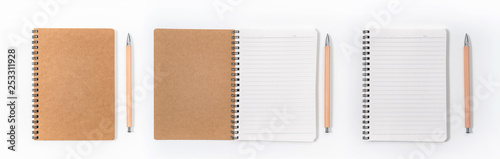 Obraz Brown spiral notebook isolated on white background.top view - fototapety do salonu
