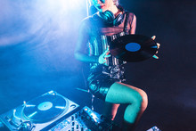 Cropped View Of Dj Woman Holdi...
