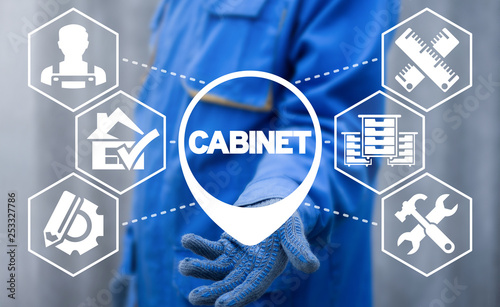 Photo Handyman uses on a virtual screen of the future and sees the word: cabinet