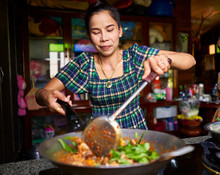 Thai Woman Cooking Traditional...