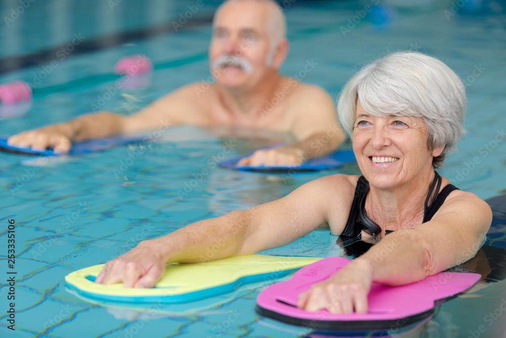 Fototapeta seniors doing water exercises
