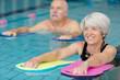 Leinwanddruck Bild - seniors doing water exercises