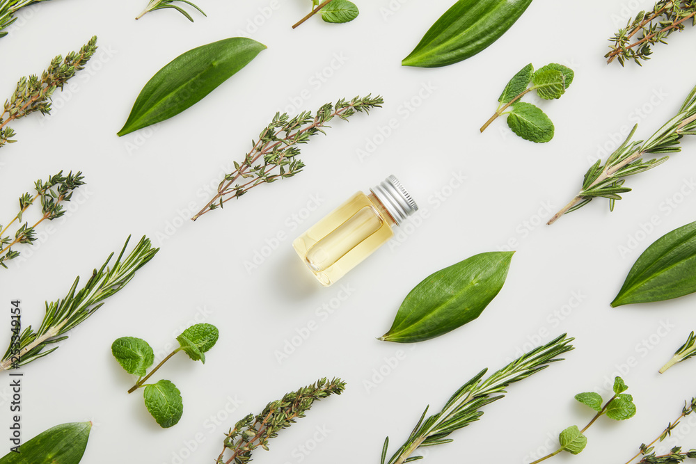 Fototapety, obrazy: Flat lay with essential oil and fresh herbs on grey background