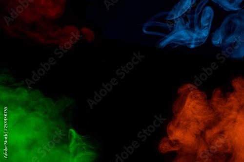 Photo sur Toile Les Textures four colorful bright clouds of cigarette vapor on a black background mystical patterns