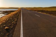 Asphalt Road In Mongolian Steppe Along A Small Lake, Mongolia