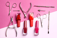 A Set Of Tools For Manicure And Nail Polish On A Pink Background With A Place For Text