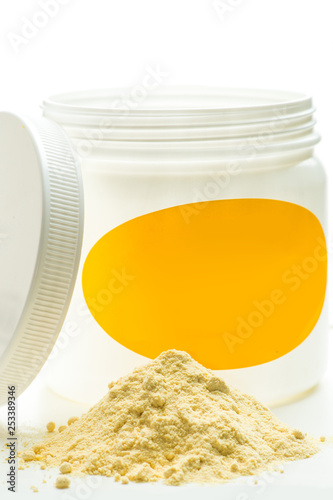 Fotografie, Tablou  Light yellow powder and can. Soya lecithin powder