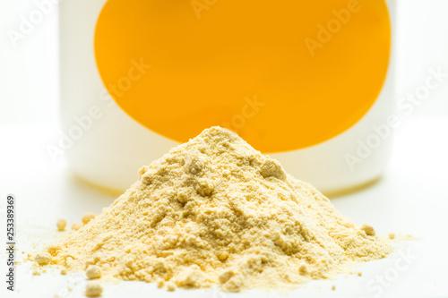 Obraz na plátne Light yellow powder and can. Soya lecithin powder