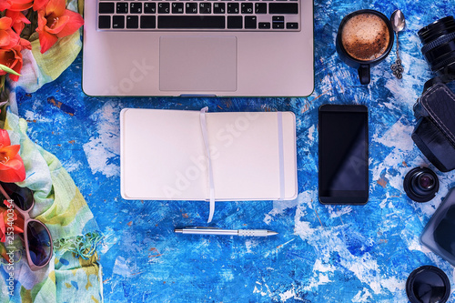 Fototapety, obrazy: Workplace concept. Views of the blue Desk with laptop, telephone, white pad and pencil. Black Cup of coffee. Flat lay. A place for your inscription. Background for site design, landing page or blog.