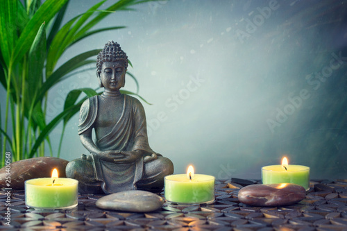 Buddha statue  on a grey background