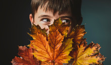 Close-up Of Boy Looking Away W...