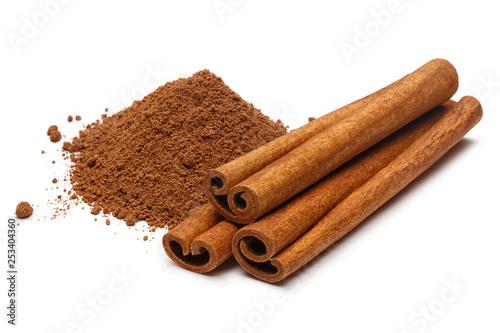 Fototapeta Cinnamon sticks and powder, isolated on white background obraz