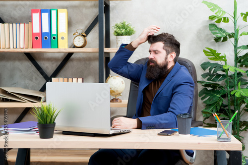 Fototapeta Forgot password. Man bearded boss manager sit office with laptop. Manager solving business problems online. Business man failed. Risky business. Broker and financial indicators. Falling stock prices obraz na płótnie