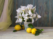 Lemons And Irises In A Vase Close-up