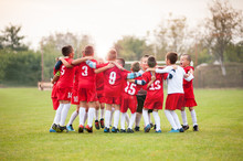 Young Soccer Players Celebrating Victory
