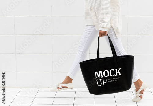 fd25d14d Person Walking with Black Tote Bag Mockup. Buy this stock template ...
