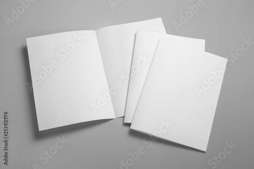 Fotografie, Obraz Blank half-folded booklet, postcard, flyer or brochure mockup template on gray b