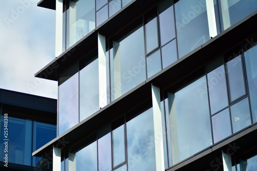 Türaufkleber Darknightsky Sky reflected in a modern building glass facade