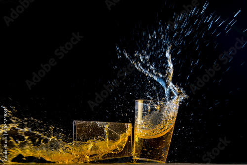 Fotografie, Obraz  Two golden tequila shots crashing