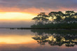 View of sunrise over the lake in nation park, Beautiful rainforest landscape with fog in morning, Thailand