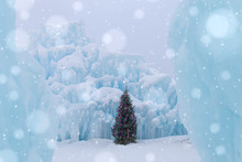 Christmas Tree With Twinkling Lights Standing In An Ice Castle