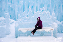 Woman Sitting On An Ice Bench At The Ice Castles