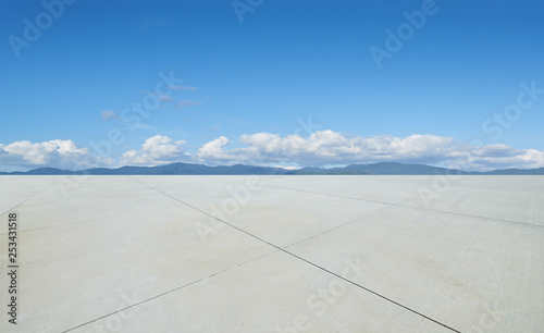 Empty concrete cement floor with beautiful landscape , sunny day scene .