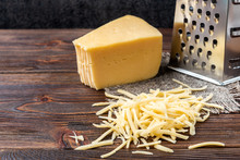 Grated Cheese And Grater On Da...