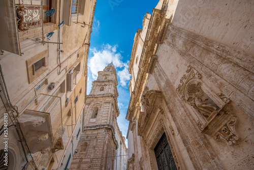 Bell tower of Cathedral Maria Santissima della Madia (Basilica Cattedrale Maria Santissima della Madia) and Fraternal Organization of our Lady of Suffrage in old town Monopoli, Puglia, Italy Tablou Canvas