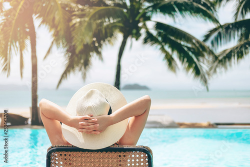 Deurstickers Ontspanning Carefree woman relaxation in swimming pool summer Holiday concept