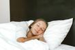 Girl sleeping in bed in hotel room