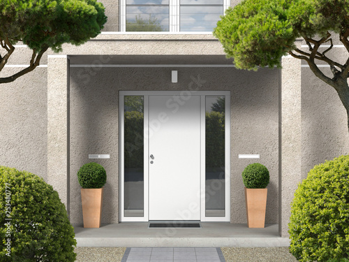 Foto  classic style house facade with entrance portal, balcony, pillars and front door