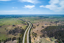 Hume Highway Winding Through Meadows And Pastures On Bright Sunny Day. Cullerin, New South Wales, Australia