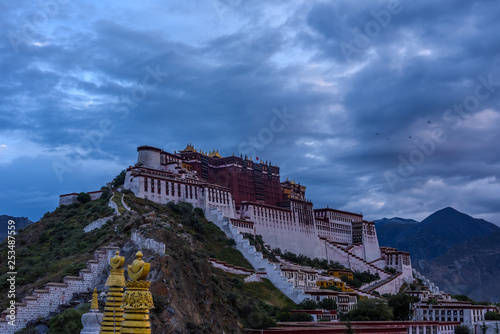 Sunrise scene of the Historic Ensemble of the Potala Palace from the south-west view platform in Lhasa, Tibet, China, which it is now a museum and World Heritage Site.